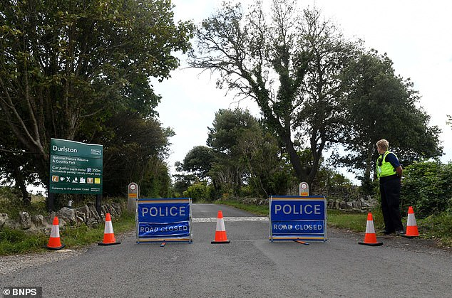 The road leading to the country park (pictured) has been closed by police, with a cordon in place