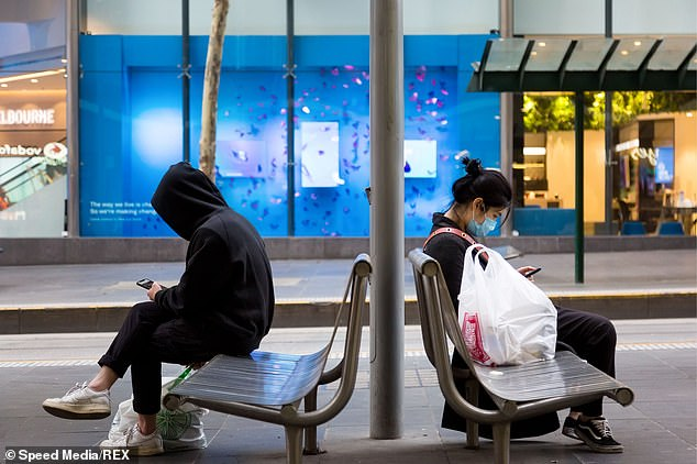 Victorian Premier Daniel Andrews announced the retail sector along with some manufacturing and administration will shut down but supermarkets, groceries and post offices will stay open. Pictured are commuters wearing facemasks in Melbourne