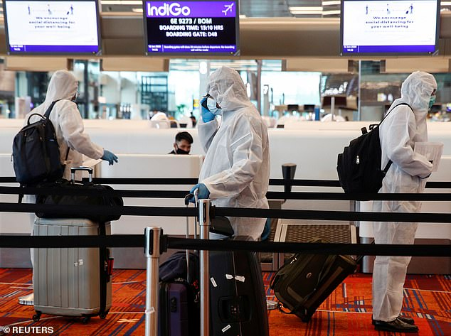 The city-state, which is also planning to give all residents a wearable virus-tracing dongle, has tough punishments for breach of its quarantine and social distancing rules (file photo)