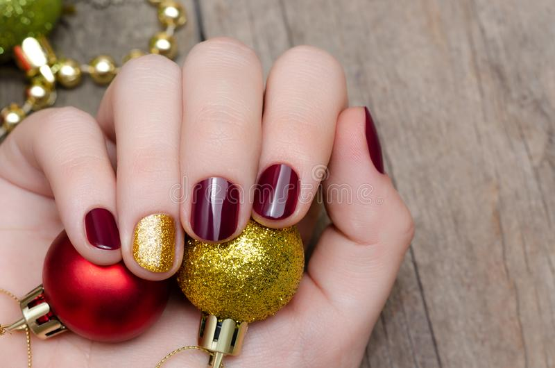 Beautiful female hand with christmas nail design royalty free stock photography
