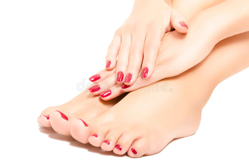 Beautiful foot and hands with red manicure stock photography