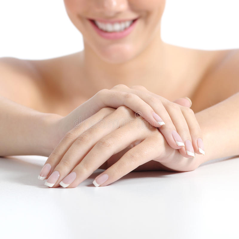 Beautiful woman hands nails with perfect french manicure royalty free stock photography