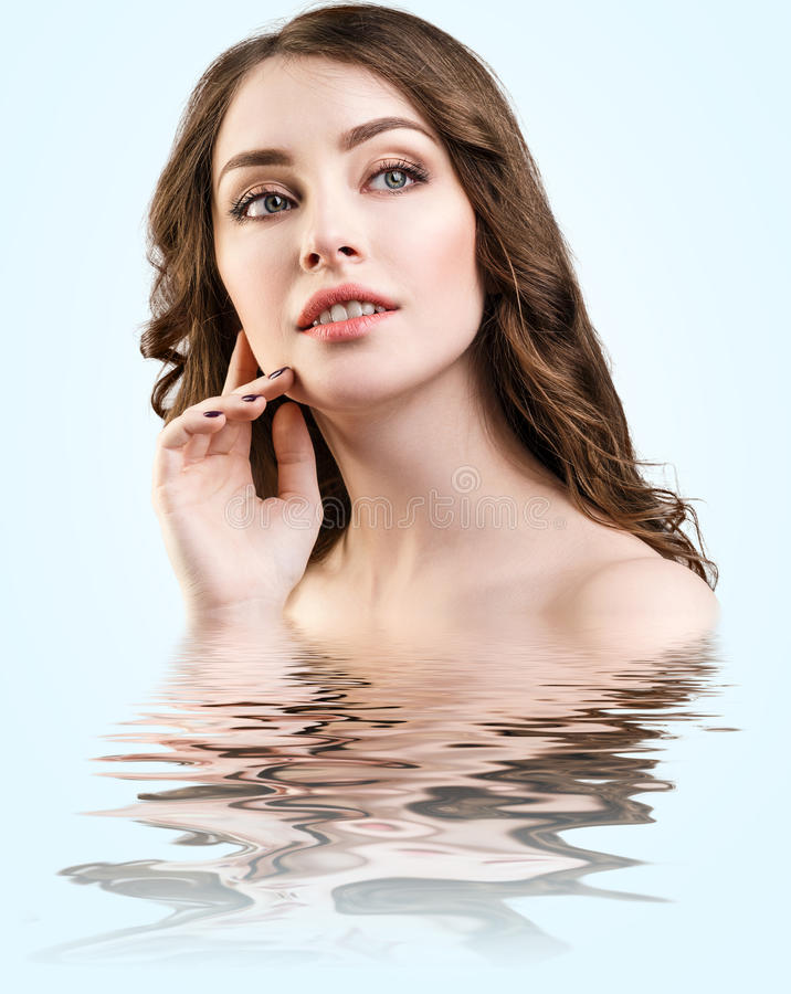 Beautiful woman with reflection on water surface. Young beautiful woman with reflection on water surface royalty free stock photography