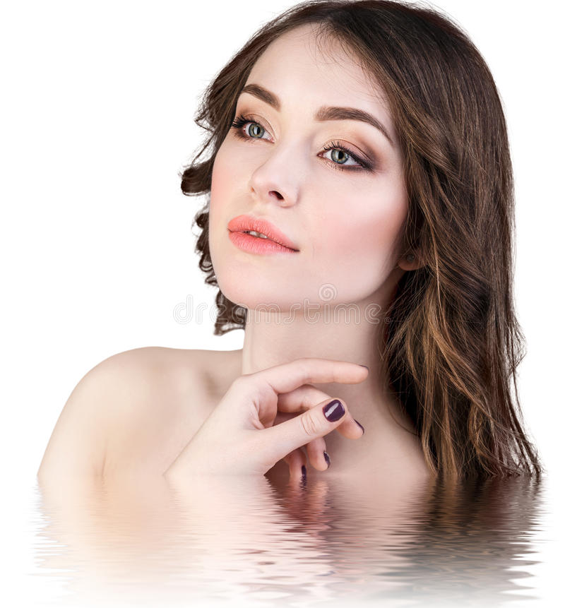 Beautiful woman with reflection on water surface. Young beautiful woman with reflection on water surface royalty free stock photo