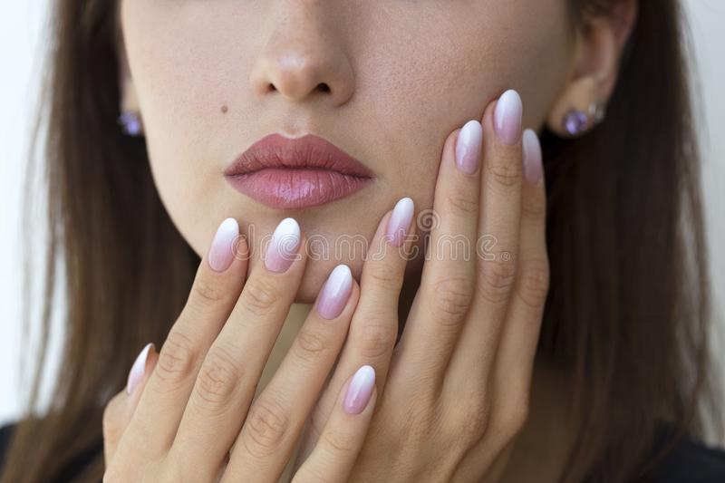 Beautiful woman`s nails with beautiful french manicure ombre royalty free stock photo