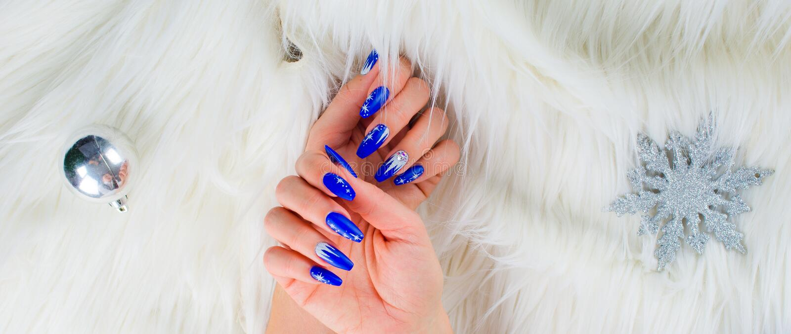 Christmas blue nails stock photo