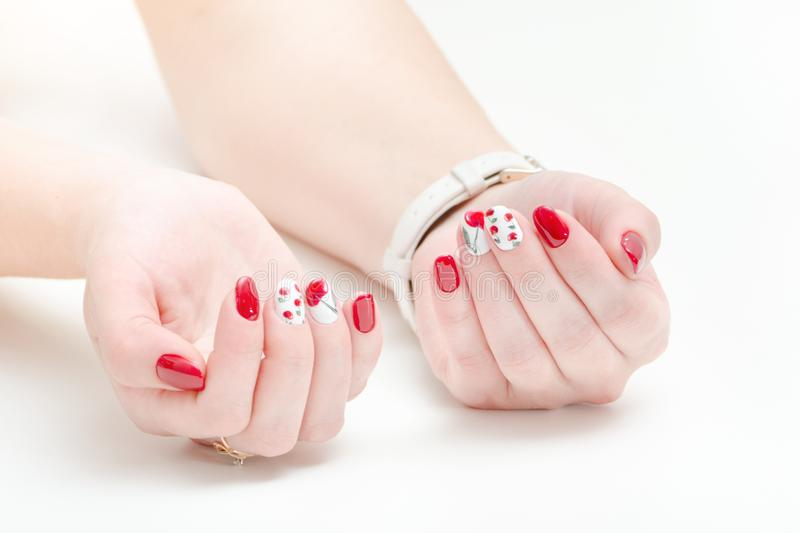 Female hands with manicure, red nail polish. White background. stock image