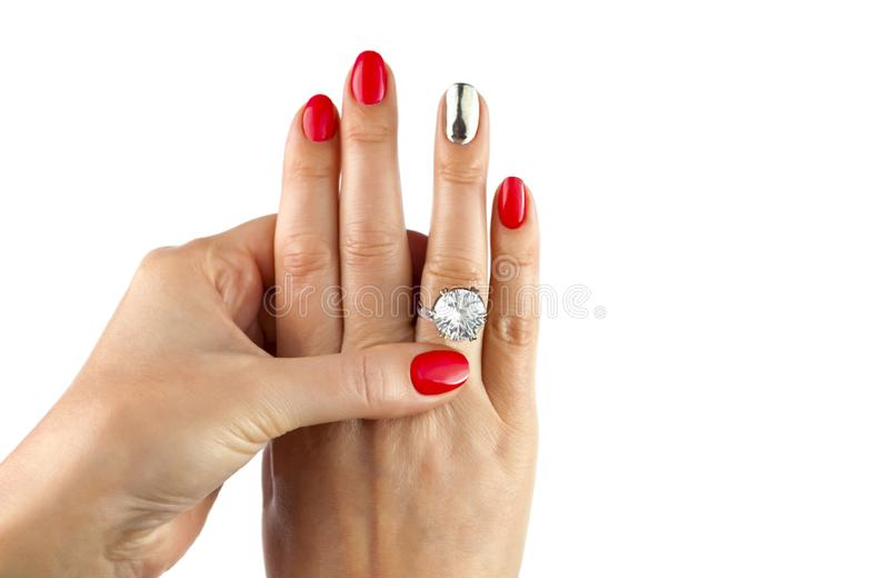 Female hands with red manicure wear a silver ring royalty free stock image