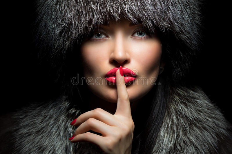 Fur Fashion. Beautiful Girl with red lips and manicure in Fur Ha royalty free stock photography