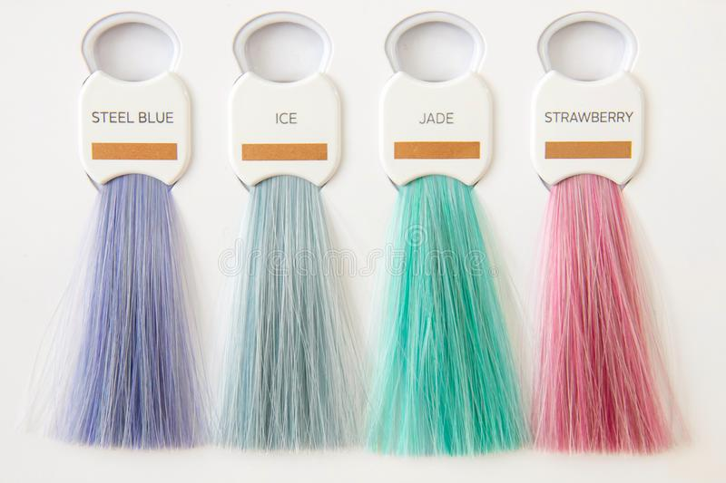 Hair palette dyed different colors. Hairstyle wig tints set for beauty industry stock photography
