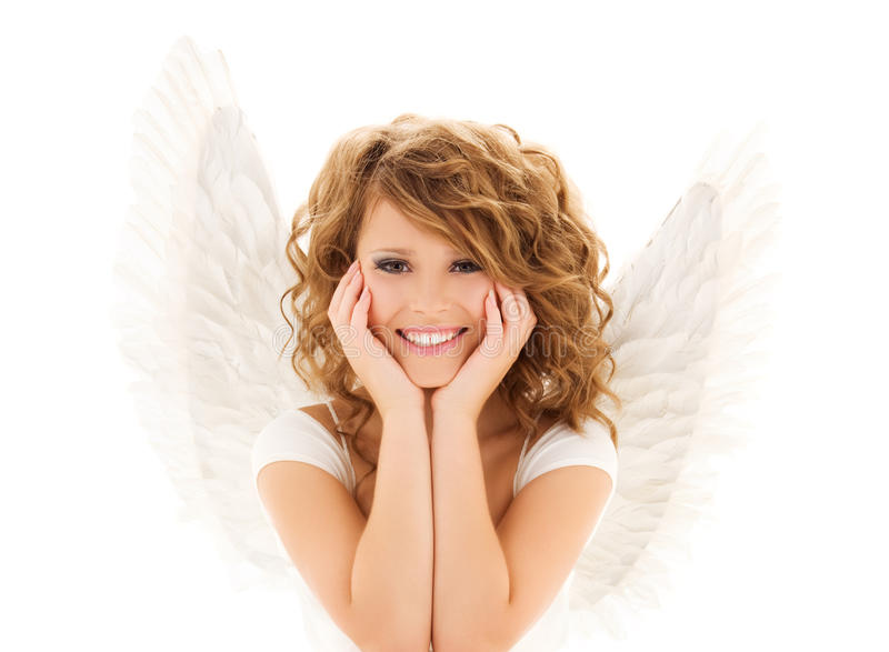 Happy young woman or teen girl with angel wings stock photo