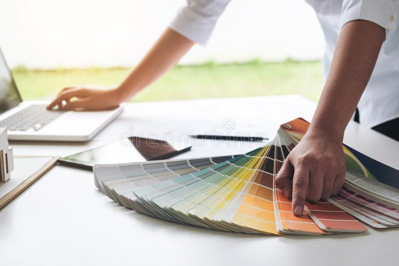 interior design or graphic designer working on project of architecture drawing with work tools and color swatches, colour chart i royalty free stock images