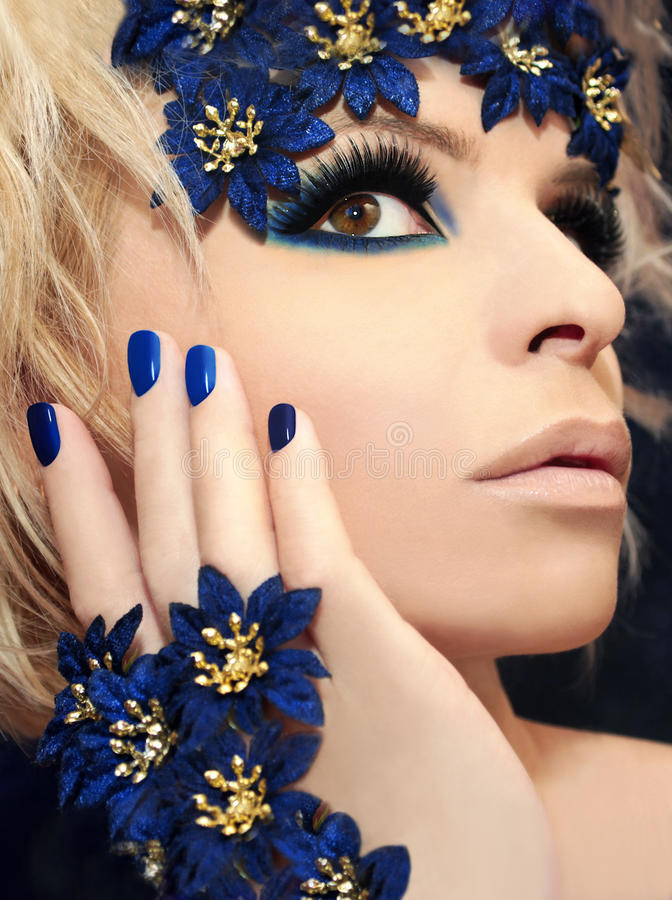 Luxurious blue makeup and manicures. royalty free stock image