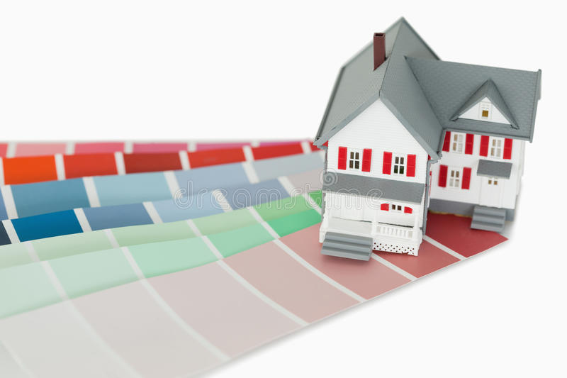 A maniature house and a color chart royalty free stock photos