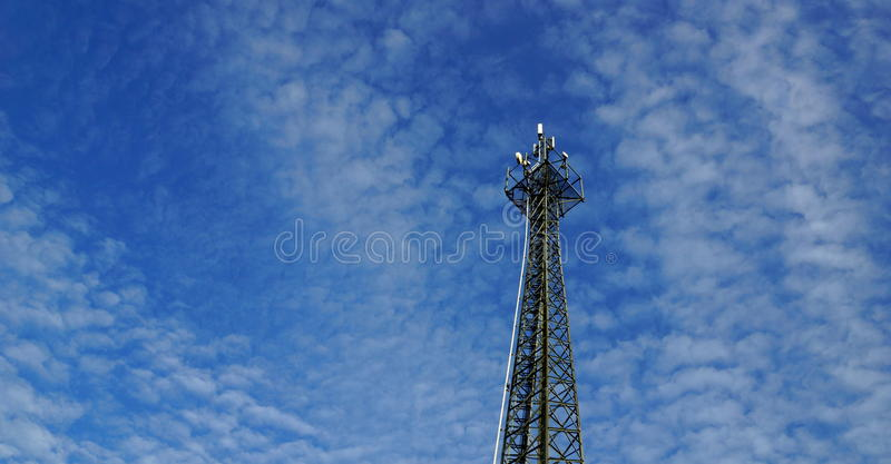 Mast radio waves. High tower for receiving and being dispatched by radio waves for mobile phones stock images