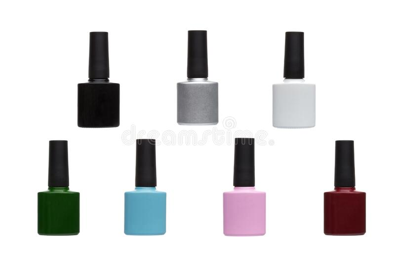 Multi-colored nail Polish jars: red, green, pink, blue, white, black, silver stock photography