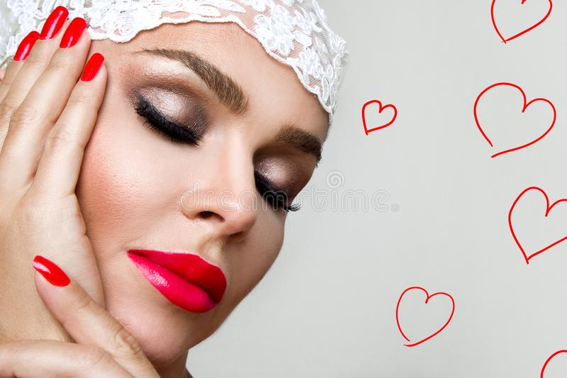 Portrait of the beautiful woman with perfect face and sensual make-up with red lips stock photos