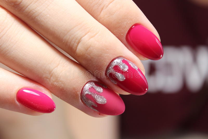 Red manicure design with silver royalty free stock image