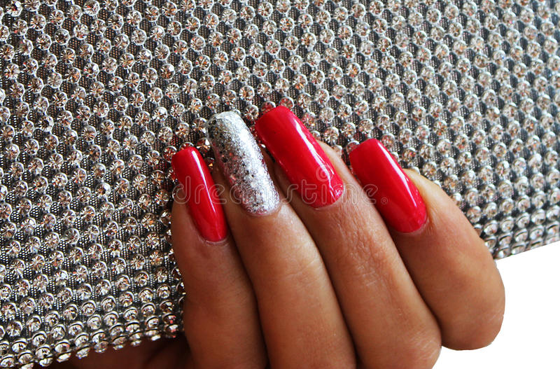 Red and silver manicure stock photography