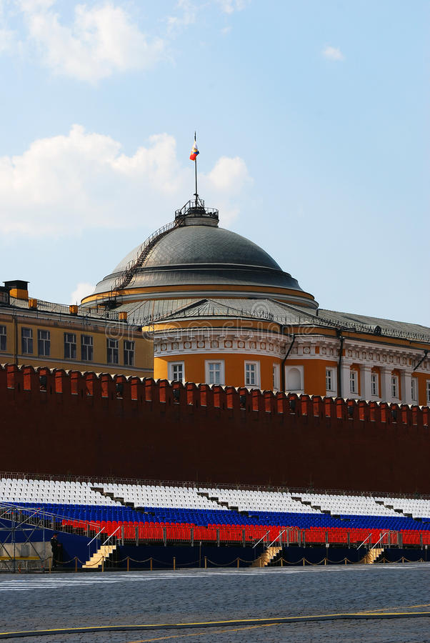 Red Square on Spring and Labor Day. Russian flag waves on the roof. View of Red Square in Moscow decorated for Spring and Labor Day (May Day) celebration. Seats stock photo