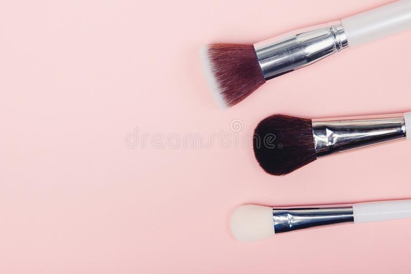 Set kit makeup brushes on pink background, copy space stock photos