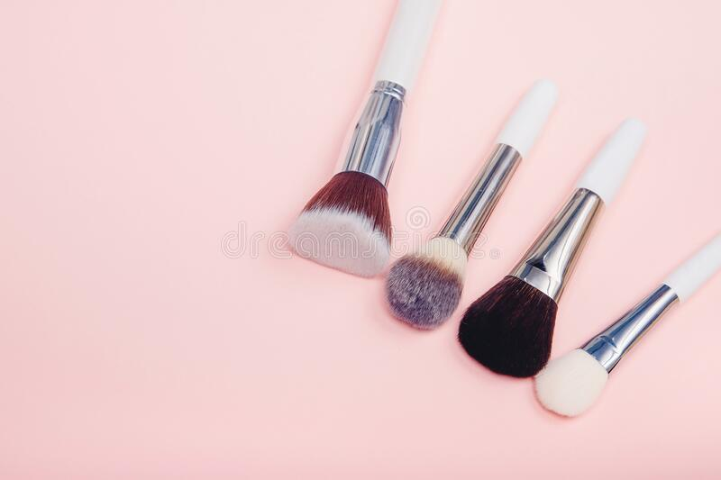 Set makeup brushes on pink color background. Top view point, flat lay royalty free stock photography