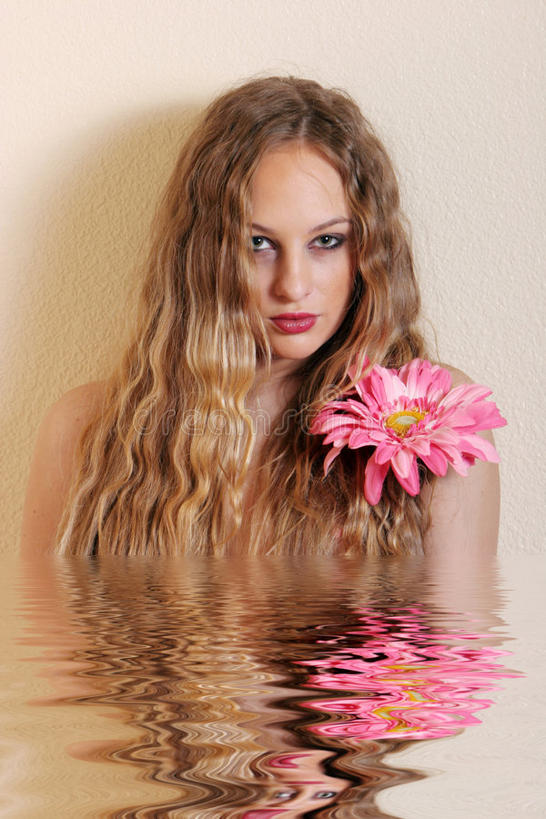 Young blond woman. With flower stock images