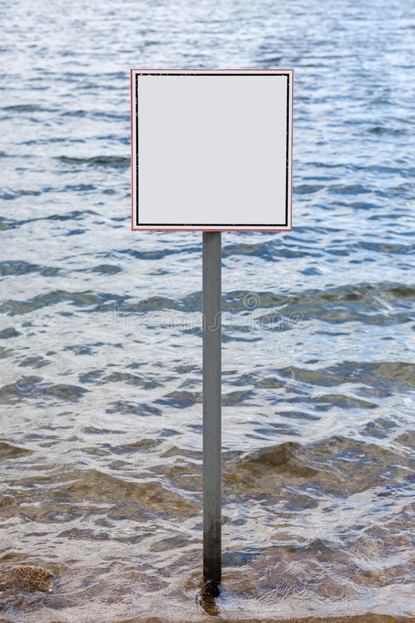 Square blank sign against waves. Of water reservoir stock photo