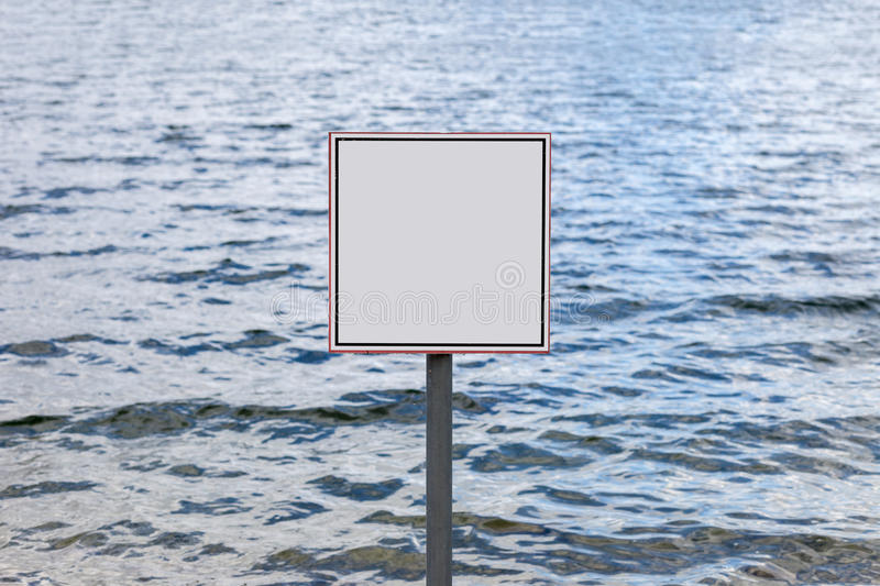 Square blank sign against waves of water reservoir. Background stock image