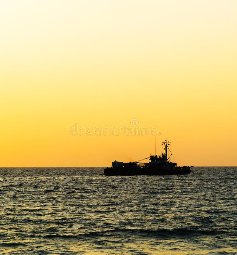 Square orange vivid ocean horizon ship silhouette background bac. Kdrop nobody blank empty space sparse vibrant bright color rich transport transportation stock images