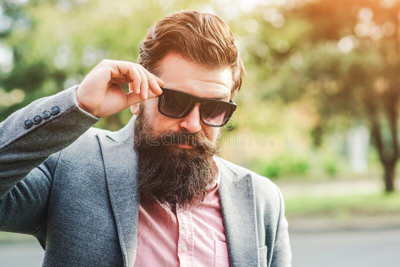 Successful bearded man in suit outdoors. Male fashion. Fashionable hairstyle and beard. Brutal confident man. Handsome bearded businessman in classic suit and royalty free stock images