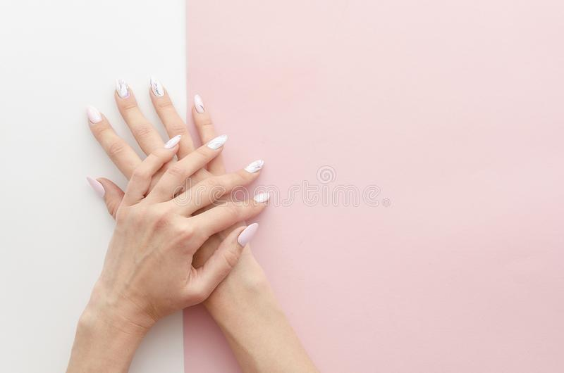 Top view woman`s hands manicure with nail painting work. Drawing on nails banner concept for a beauty salon with copy stock photo