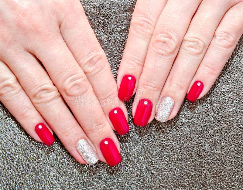 Woman`s nails with beautiful red manicure fashion design stock images