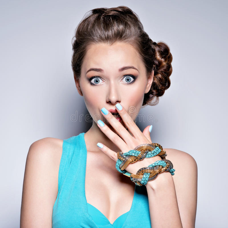 Young beautiful woman with jewelry. royalty free stock photo
