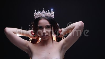 Female model in the crown posing in the studio jewelry stock video