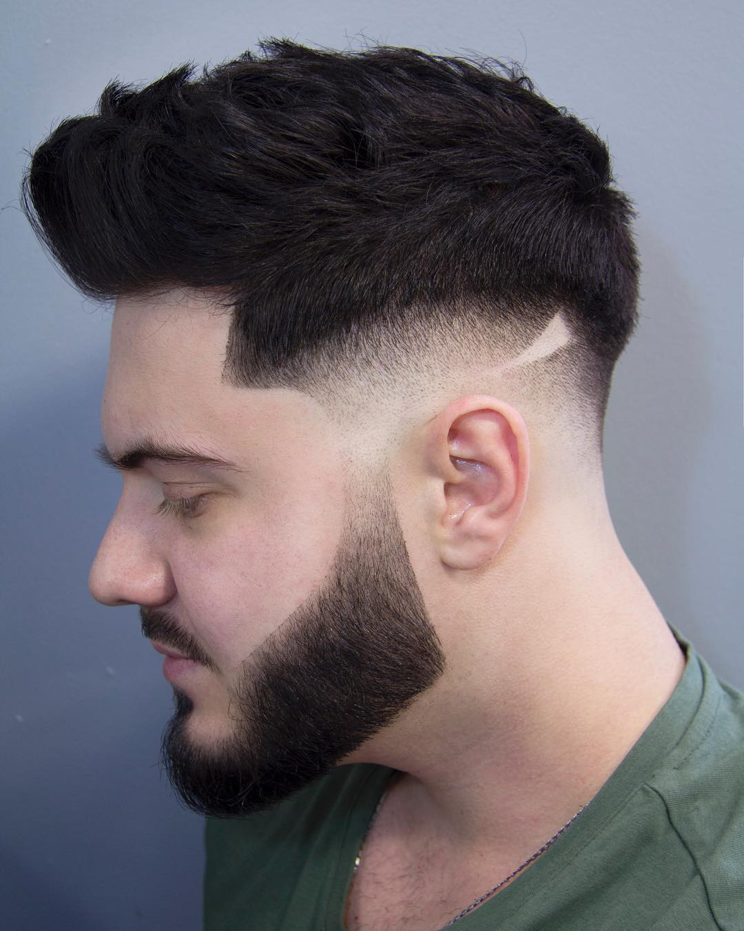 messy pompadour with shaved sides